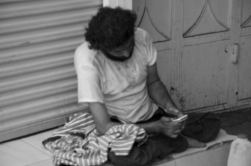 beggar with cellphone?