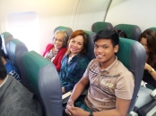 inside the plane with my mom and nephew aron