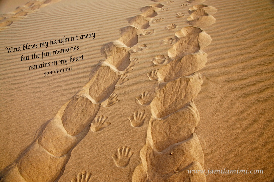 handprint in the sand