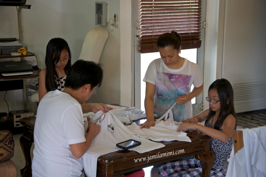 cutting out old shirts - family bonding time!