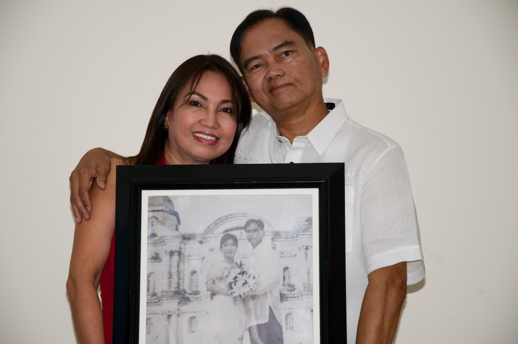 carrying the picture of their renewed vow on 25th year of marriage